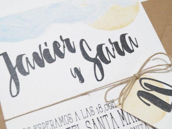 detalle de la invitación de boda en la playa